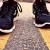 Geelong Podiatrist Luke Bertram examines feet in sneakers as part of Sports Podiatry consultation